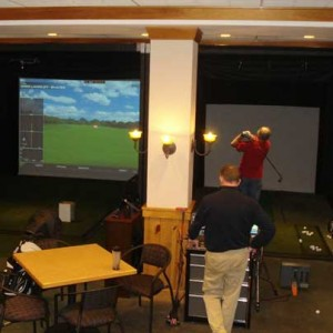 PGA Pro helps a golfer with indoor golf practice