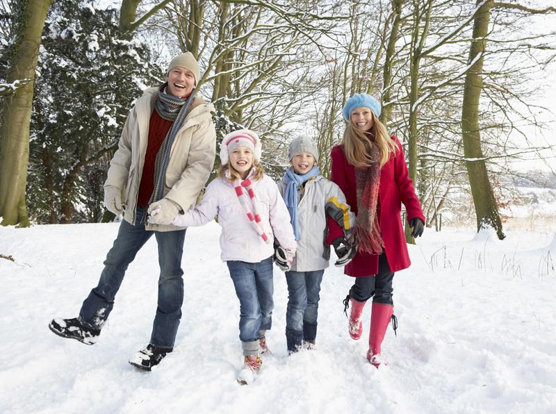 A family enjoying winter vacation deals at Cragun's Resort