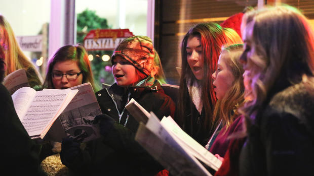 Students from Pequot Lakes sing carols during Nisswa City of Lights
