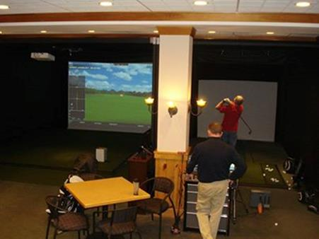 Players Using Golf Simulator at Cragun's Resort