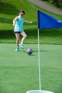 Amber Campbell kicks the ball to the cup on the new Footgolf course at Cragun's Legacy Courses. Photo credit: Brainerd Dispatch/Steve Kohls