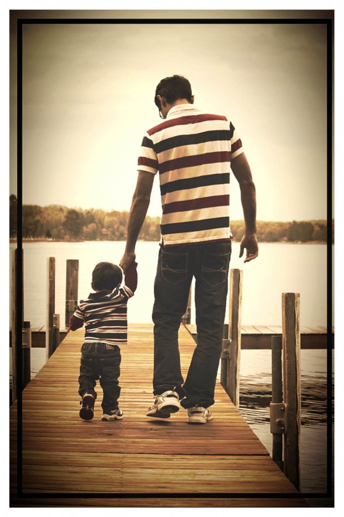 Son and dad walking on Cragun's dock.
