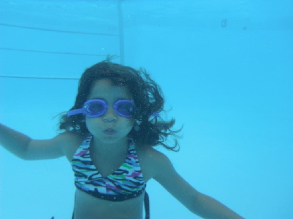 Having fun swimming at Cragun's Resort.