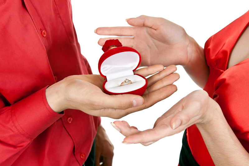 A couple in the midst of a holiday engagement