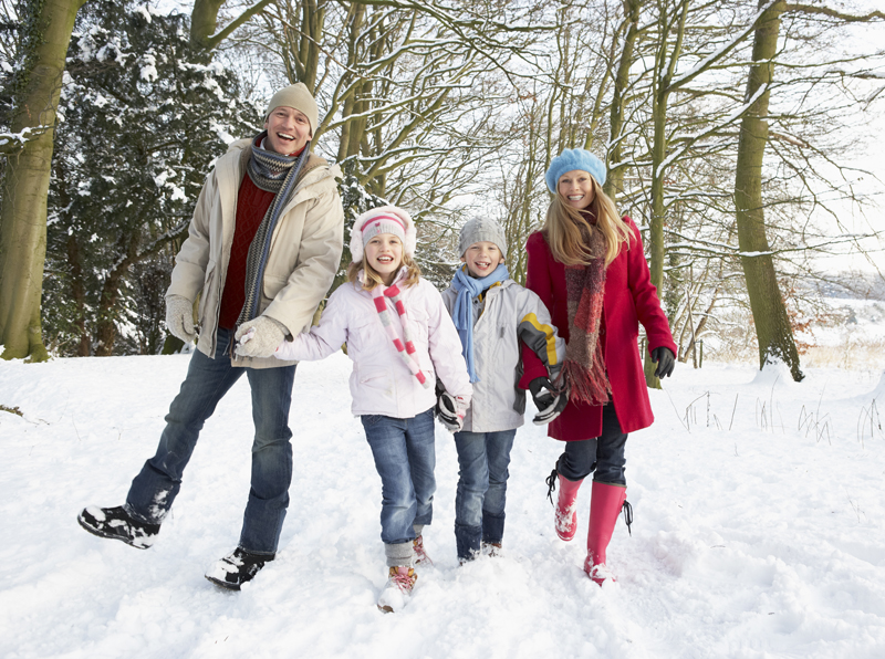 A family enjoying winter vacation deals at Cragun's Resort