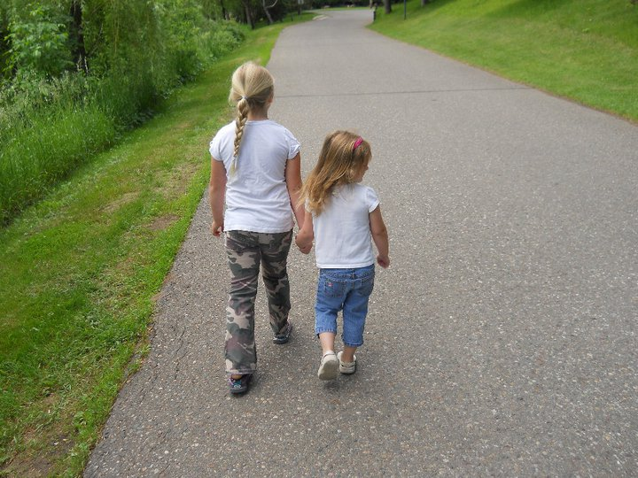Sisters taking a walk along the lake at Cragun's Resort in Brainerd, MN