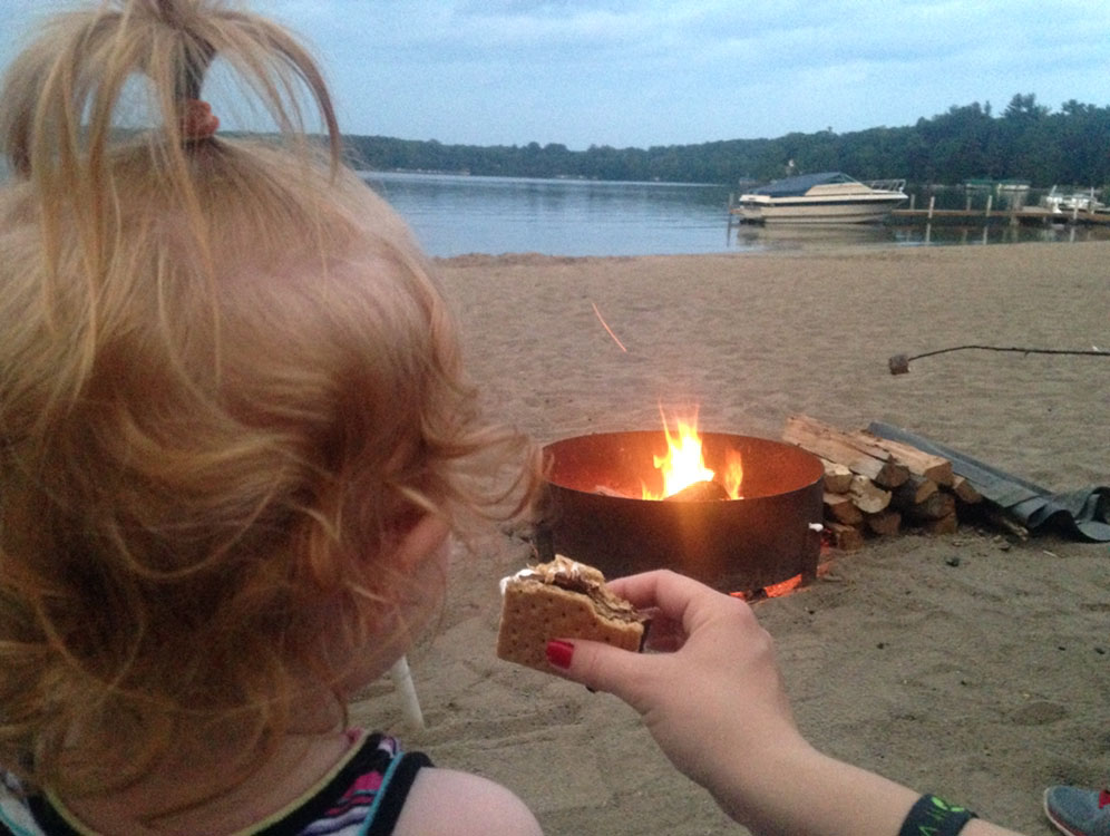Roasting marshmallows on the beach at Cragun's Resort