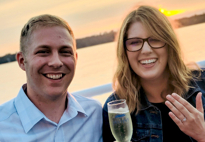 Couple announcing their engagement on a Gull Lake Cruise