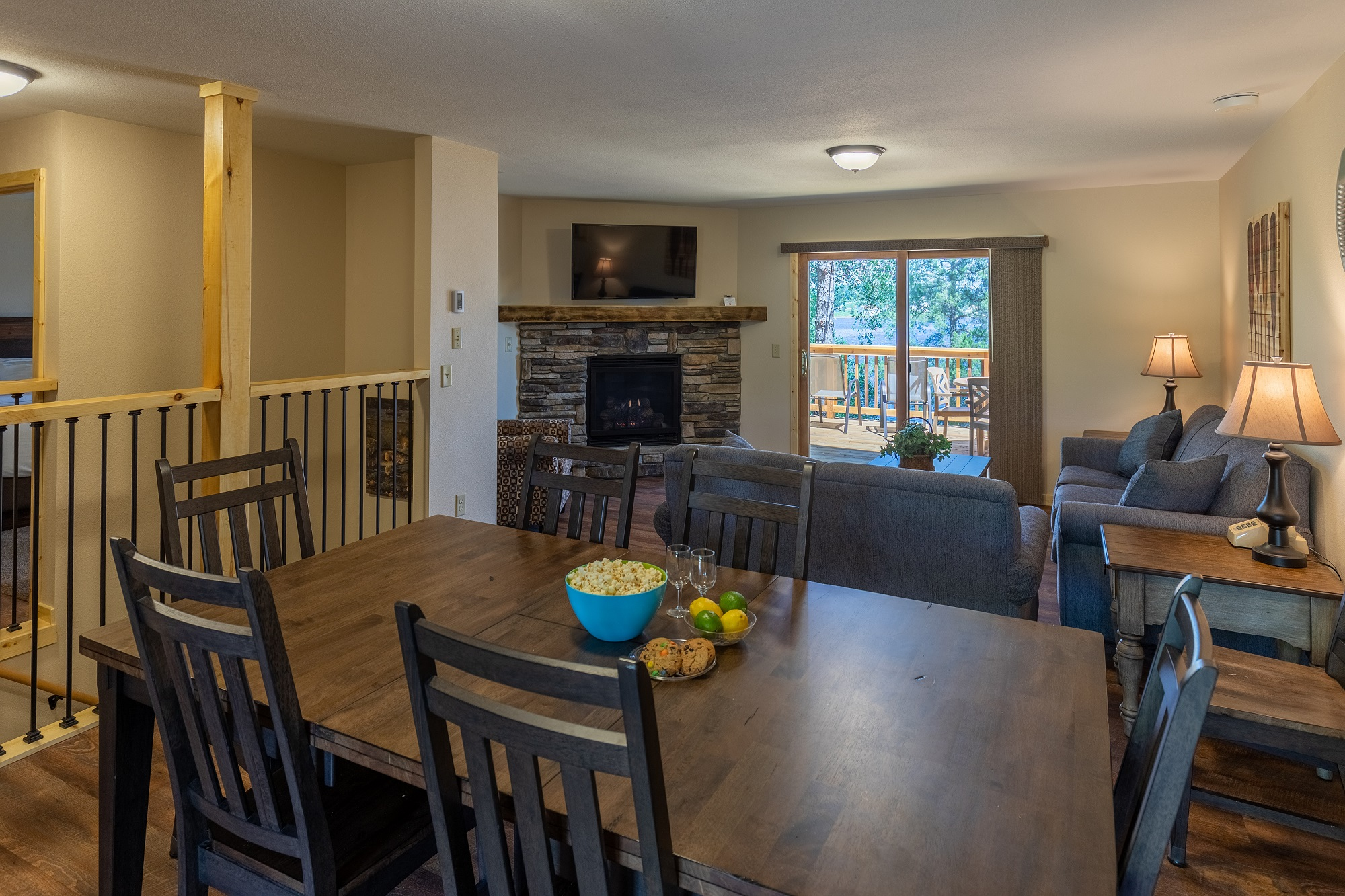 Dining room table with living room view and fireplace at our Gull Lake Resort